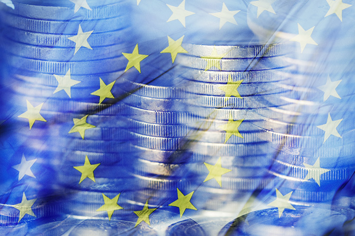 euro coins and the flag of the European Union